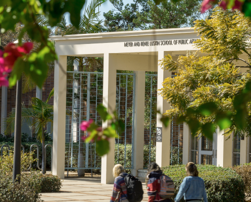 Students walking by the entrance to the Luskin School of Public Affairs
